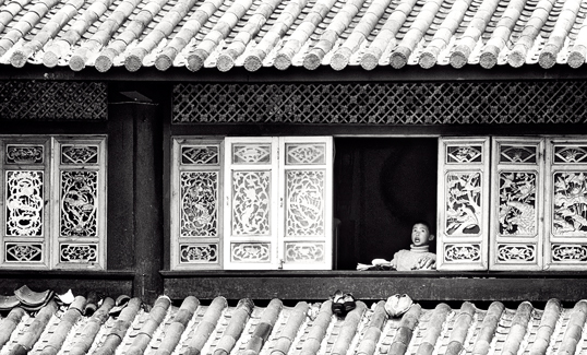 Link to image of Break Into Song, boy singing in Lijiang
