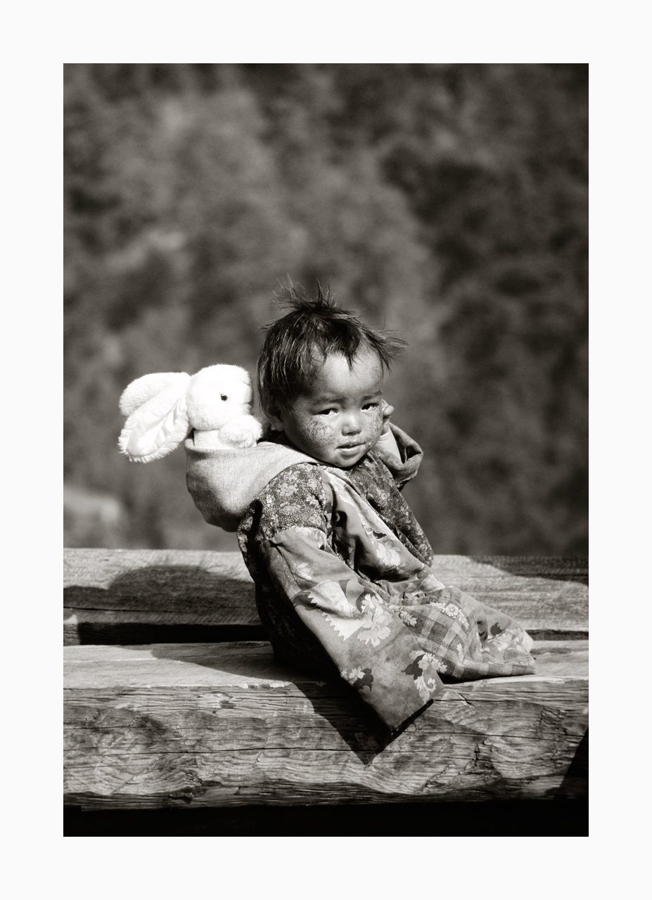 Fine art image of a Langtang valley infant with white toy rabbit from the '90s, Nepal.