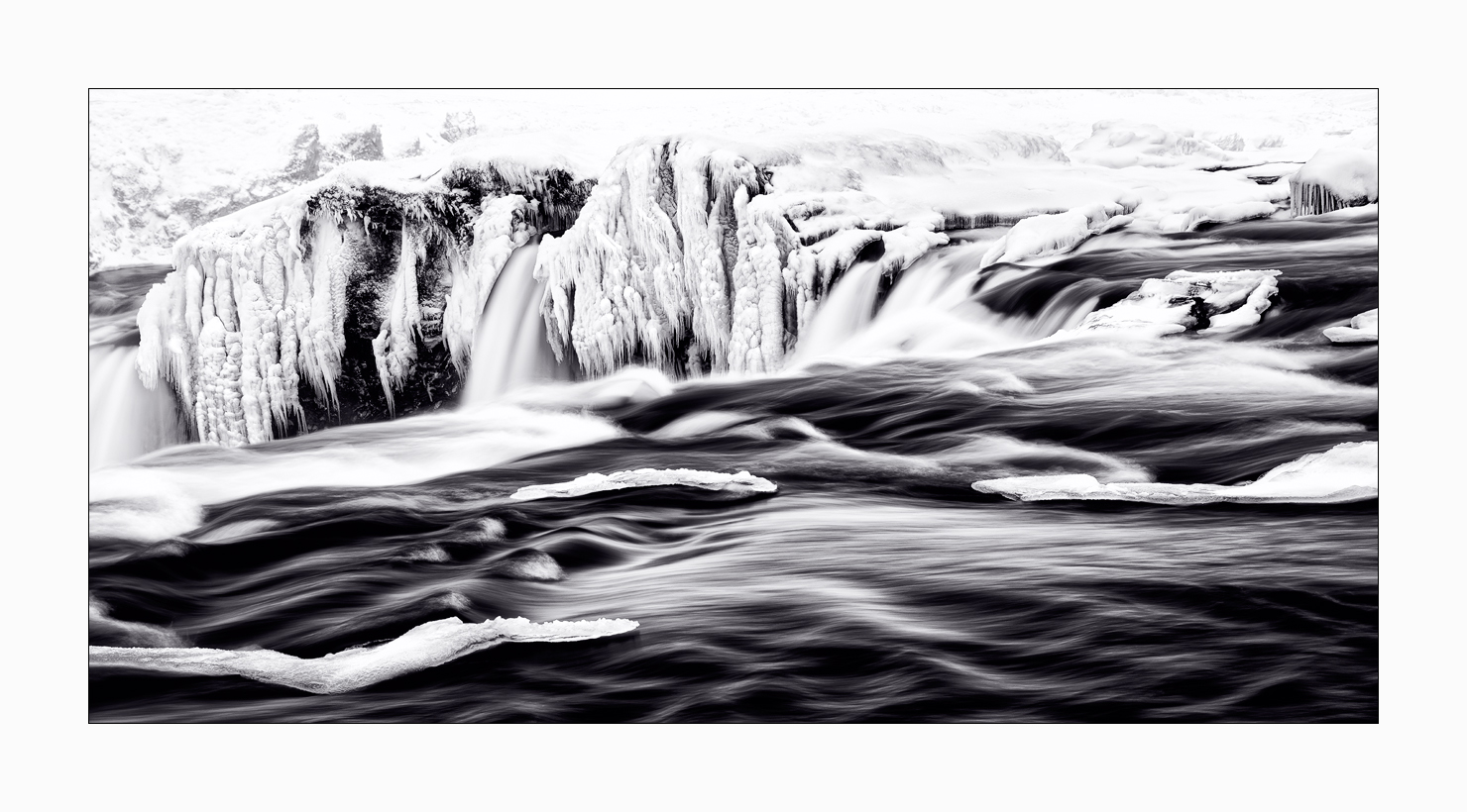 Fine art image of the upper waters of Godafoss in winter in Iceland.