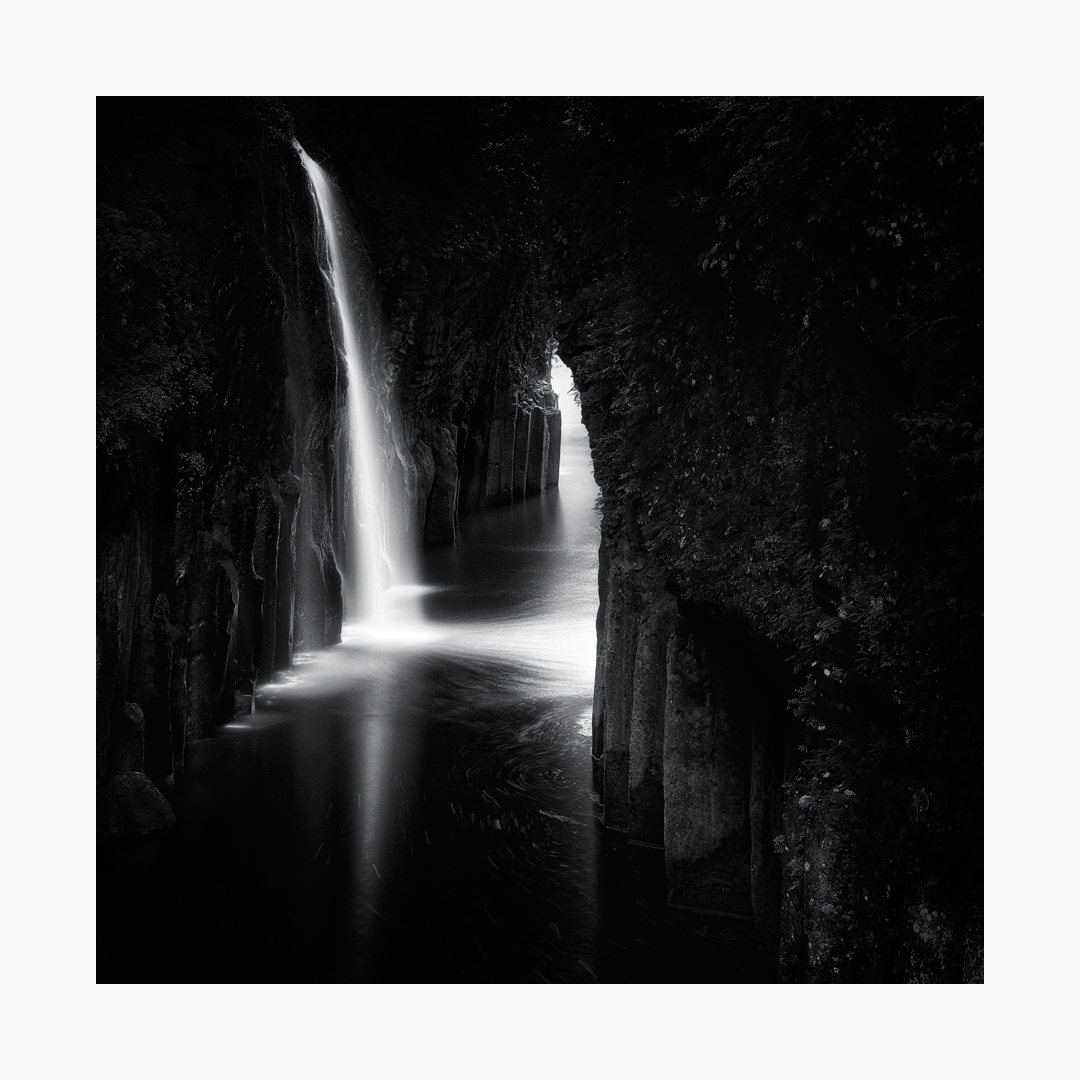 Black and white fine art image of the Manai Falls of Takachiho Gorge, Japan.